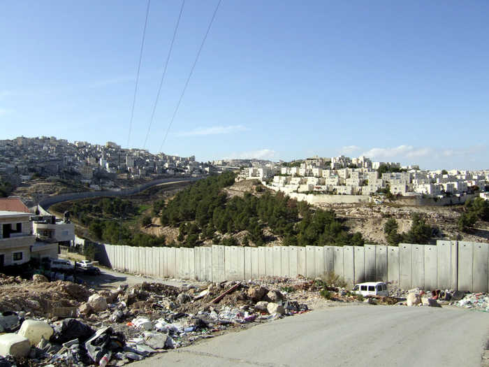 The Wall with L refugee camp of Shefat, Israeli settlement ahead (taken from east Jerusalem)