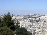 On left the Dome of the Rock; ahead Mt of Olives; east Jerusalem beneath (62 kbytes) - Click to enlarge
