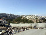 The Wall with L refugee camp of Shefat, Israeli settlement ahead (taken from east Jerusalem) (60 kbytes) - Click to enlarge
